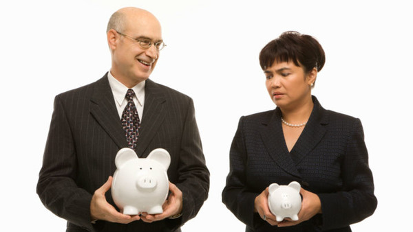 Man and woman with piggy banks